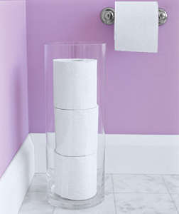 Toilet paper stored in clear vase