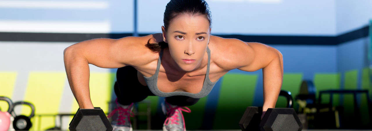 Image of woman doing pushups